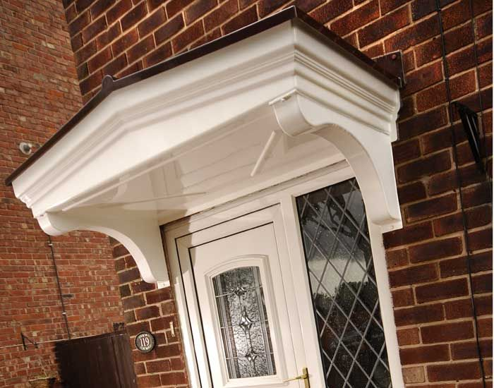 A door canopy is a functional addition to the entrances of ...