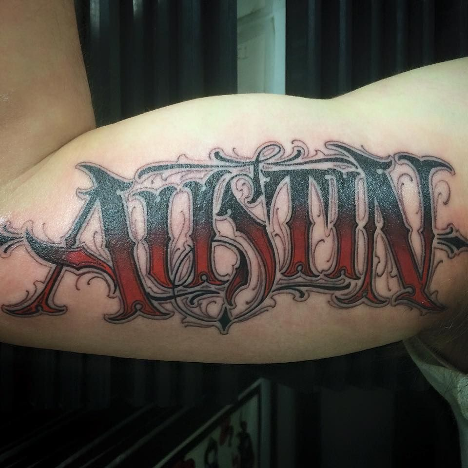 black and grey red custom lettering tattoo by salvador diaz at