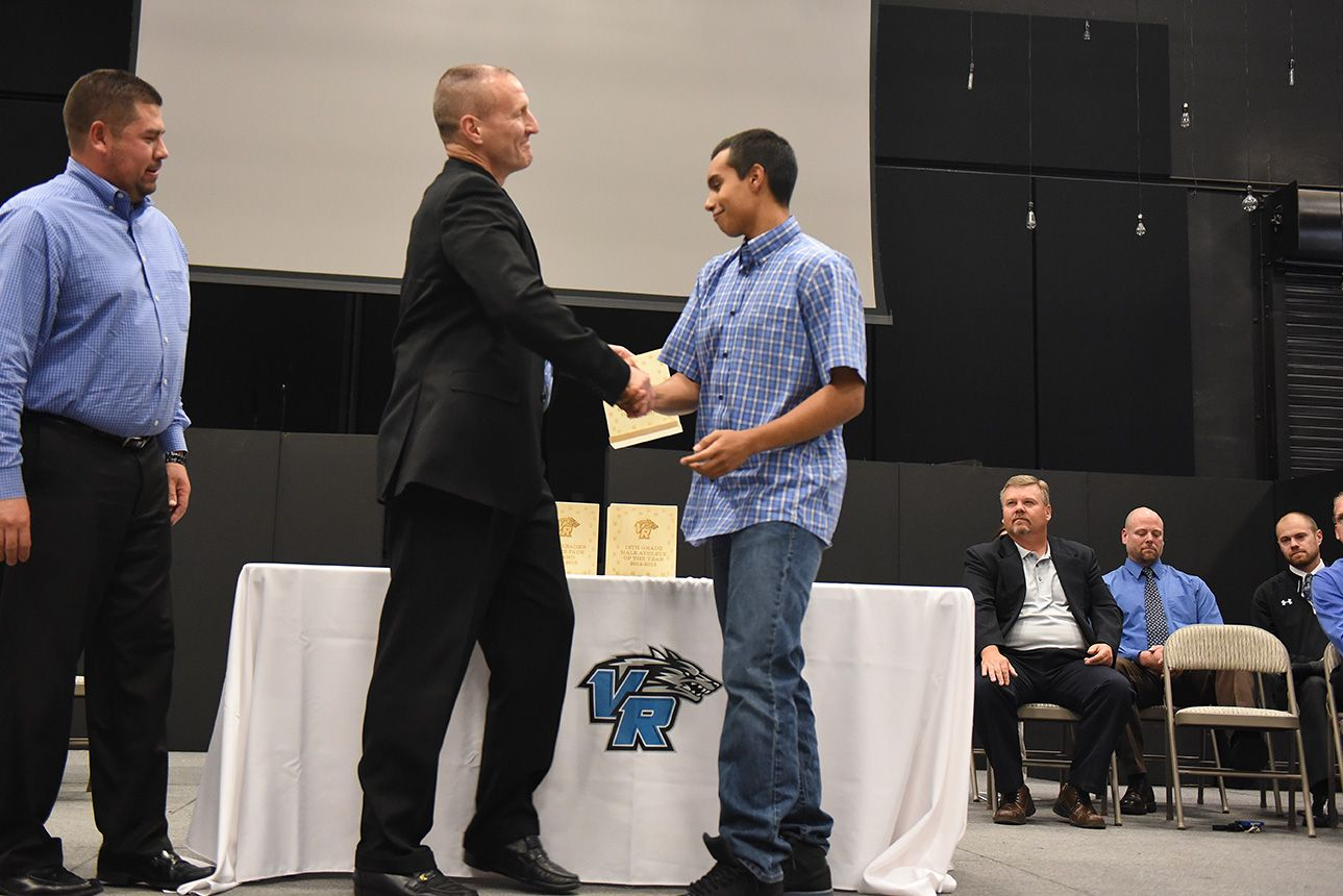 Eleventh-grader Robert Fernandez, 17, accepts an award May 12 during the 2015 Athletic Awards Ceremony at Vista Ridge High School. Fernandez lettered in track, football and basketball. He is also tied for the all-time leading receptions at the high school.
