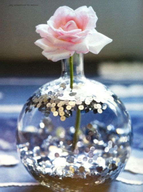 Sequins in water... pretty and simple.  Would work in a large flower vase too, this one looks too delicate to leave around my kids.