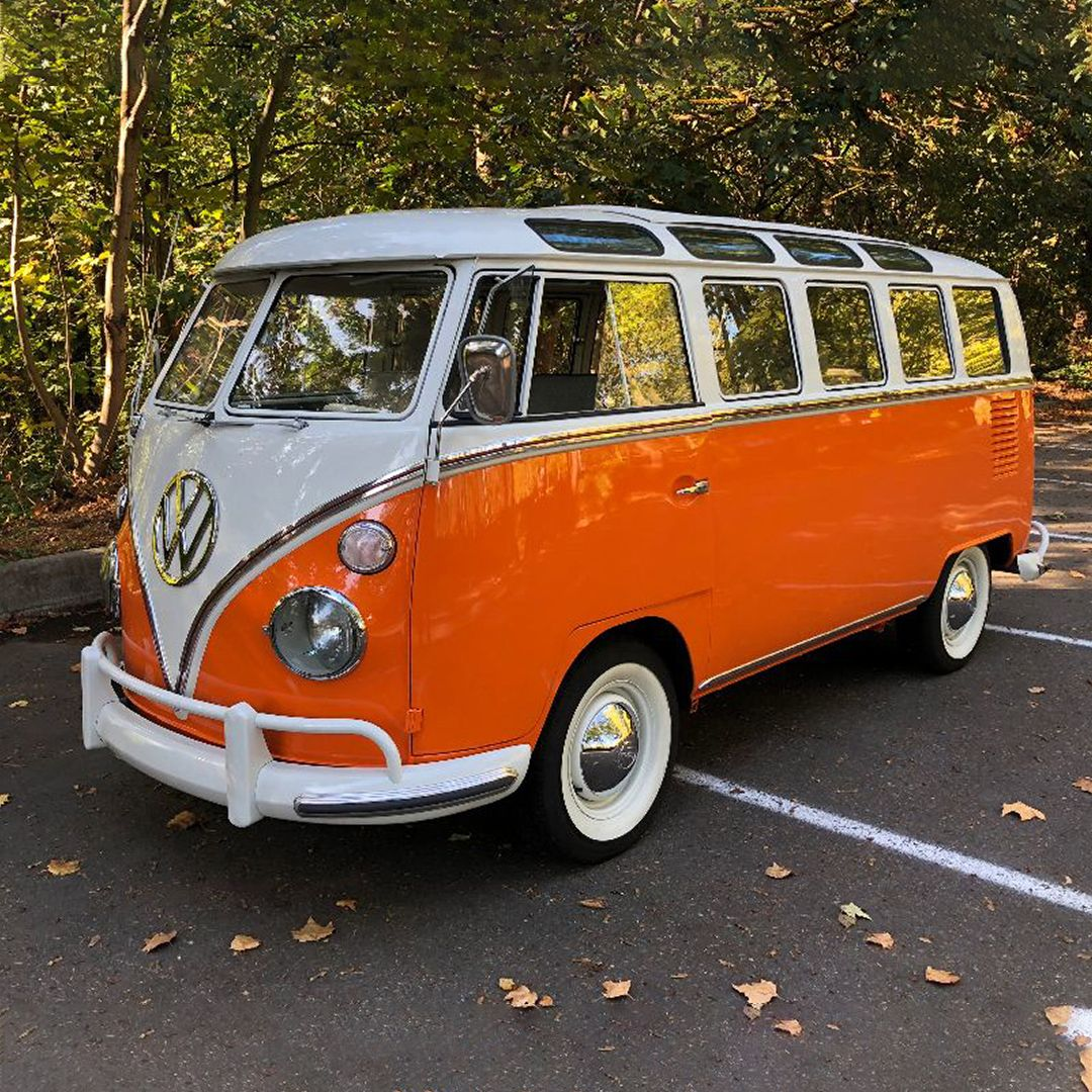 Finished in orange and white paint with a salt and pepper interior, this 1965 Volkswagen started life as a 13-window bus and was converted to a 21-window Samba bus. #volkswagen