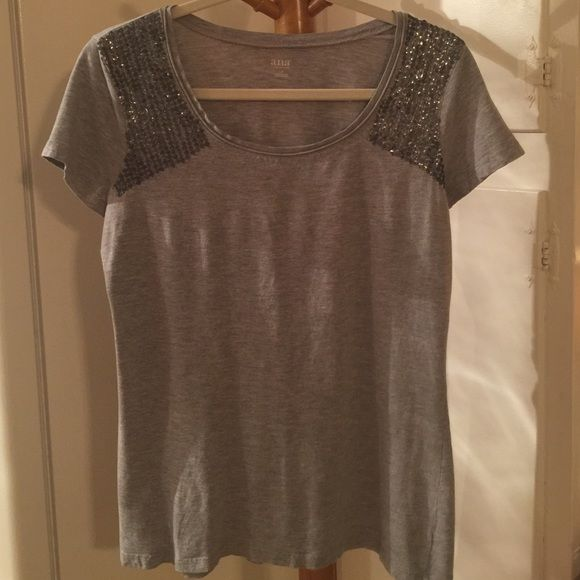 """a.n.a Gray Sequin Shoulder Tee Good condition no stains, holes or pilling ANA gray heathered sequin shoulder tee. Bust 20"""" across, 25"""" length. Happy Poshing  a.n.a Tops Tees - Short Sleeve"""