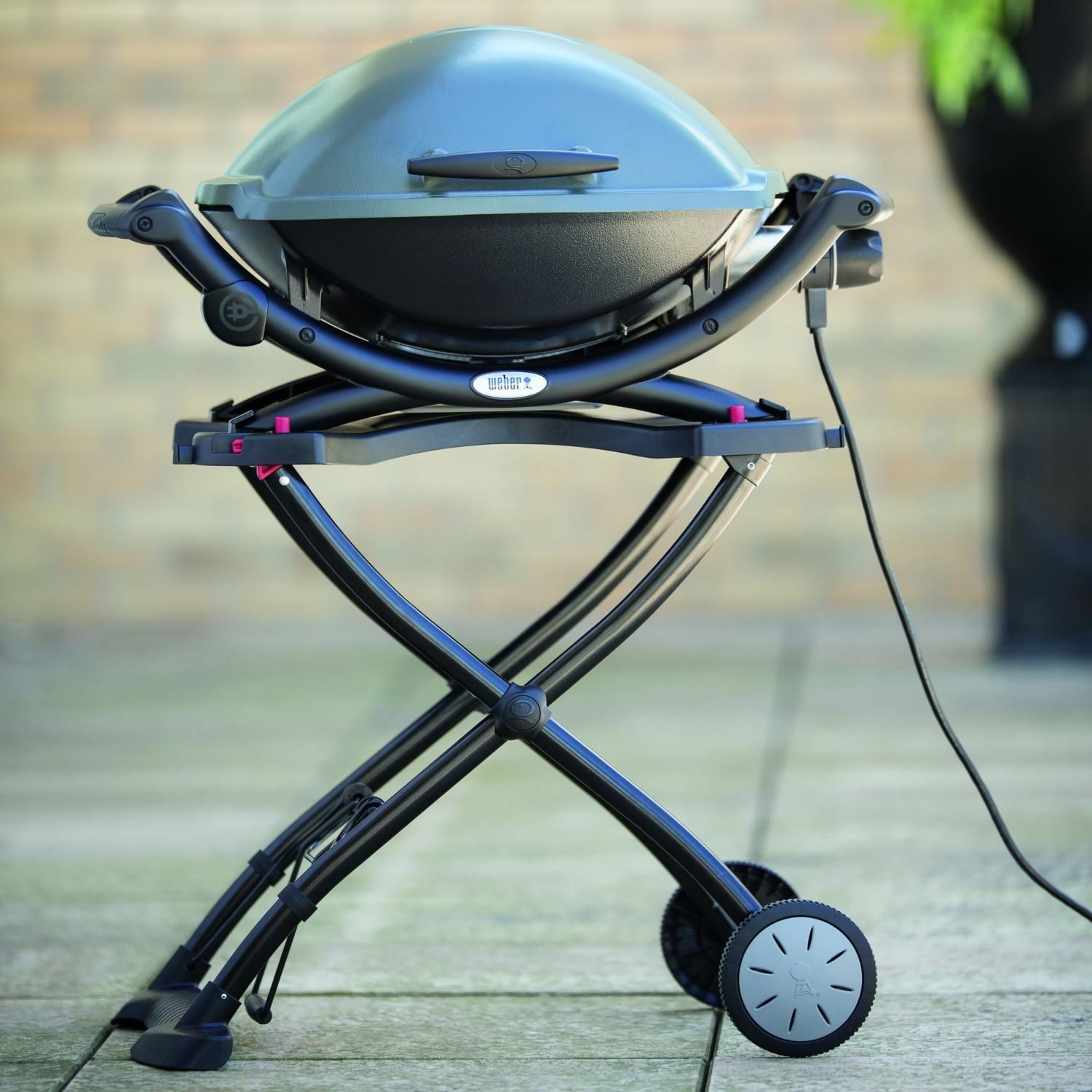 Weber Q 2400 Portable Electric Grill Shown On Optional Cart