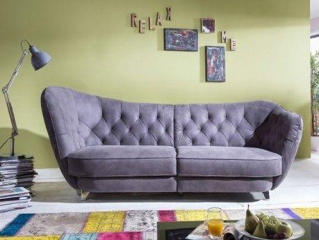 die couch berzeugt durch top preis top marke geschwungenes design retro look r ckenteil. Black Bedroom Furniture Sets. Home Design Ideas