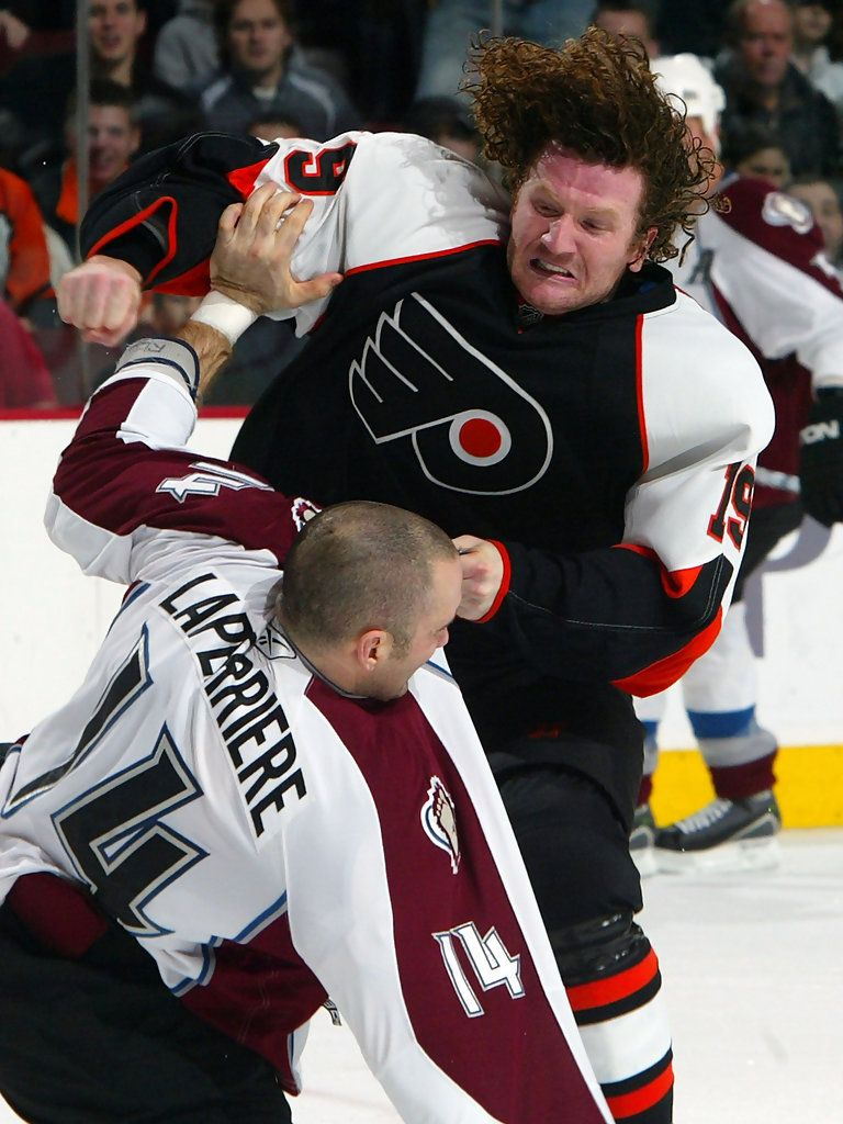 Ian Laperriere taking a beating by Scott Hartnell