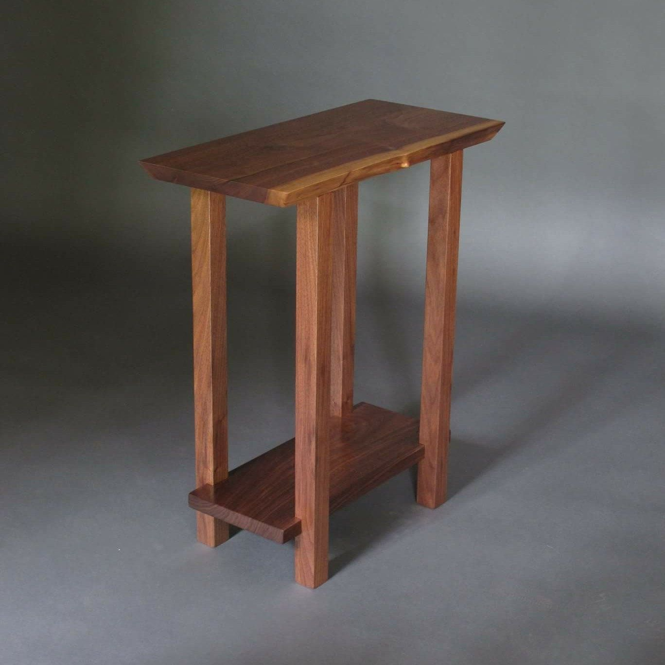 This small narrow table with a live edge table top was created from