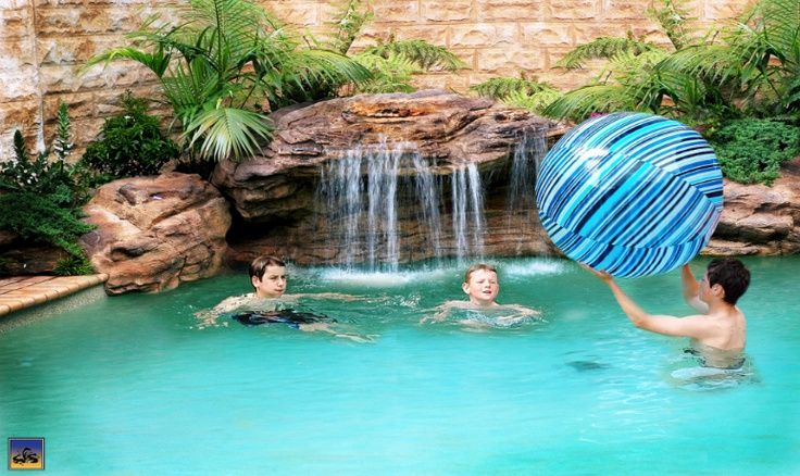 Diy waterfall pictures swimming pool rock waterfalls and for Beautiful swimming pools with waterfalls