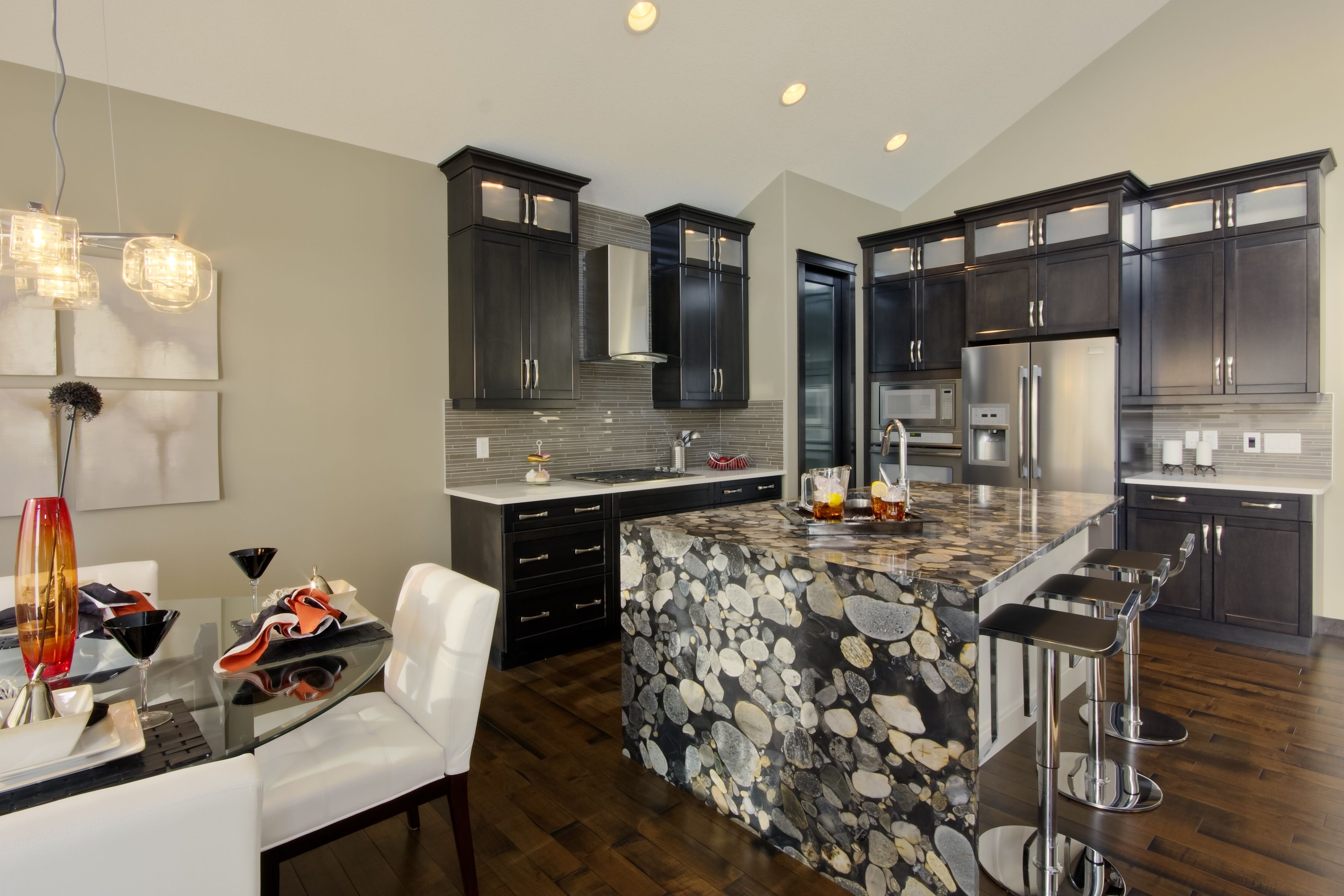 Natural stone granite countertop with waterfall down one side of