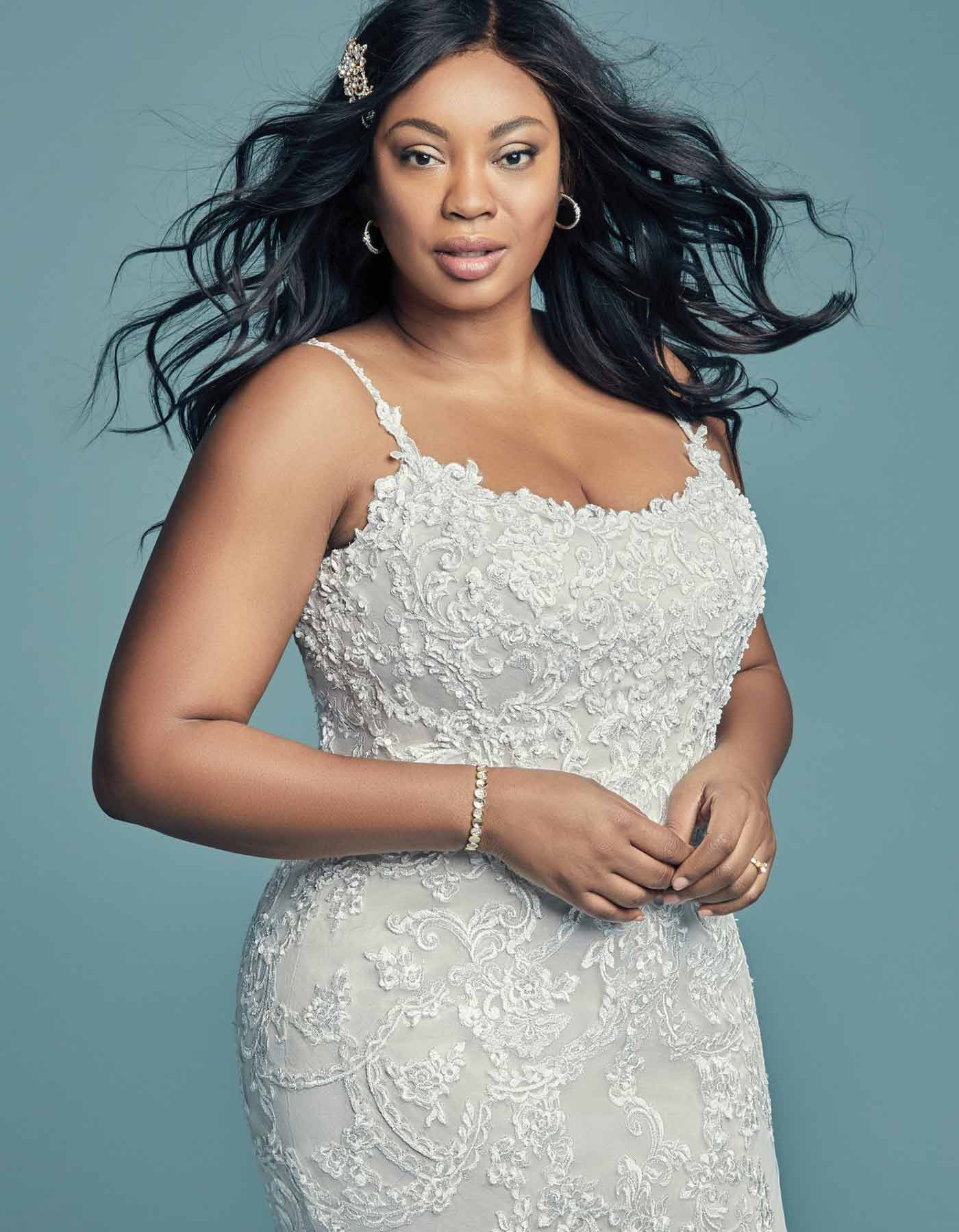 18ee2bdea37 Beaded lace motifs dance over sequin tulle in this soft yet alluring wedding  gown.  MaggieSottero  RaffaeleCiuca  WeddingDress  PlusSize  Curve