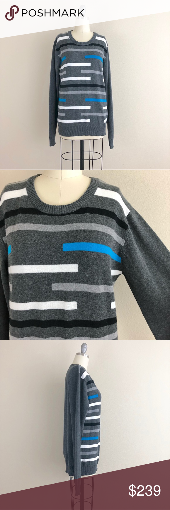 28a5ddd11 Gucci Striped Sweater Gucci striped men's sweater. Could also be worn by a  woman. Dark gray with half stripes in blue, white and black.