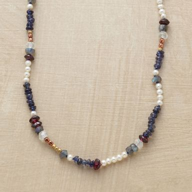 VARIATIONS ON THEME NECKLACE--Similarly sized beads express their individuality with color: from white cultured pearls to deep red garnets, purple iolites to brass and copper. Handcrafted Sundance exclusive