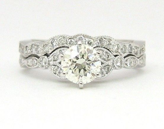 Love how the wedding ring and engagement ring fit together! On both sides though. In gold!
