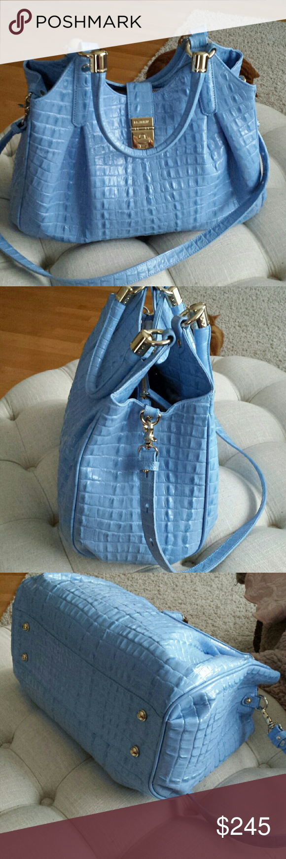 Brahmin Elisa bag Beautiful Brahmin Elisa bag this is a beautiful blue color turn lock closure has a middle zip compartment on one side is two pockets with pen holder the other side has a zip pocket with key fob if it's in excellent condition feet on the bottom extra shoulder length handle beautiful pristine condition no flaws Comes with a dust cover 13.5x10x6approx Brahmin Bags Shoulder Bags