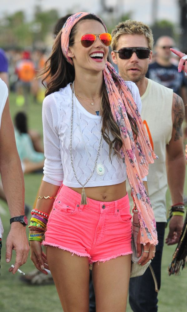 Alessandra Ambrosio at Coachella Festival wearing orange/pink Ray Ban sunnies