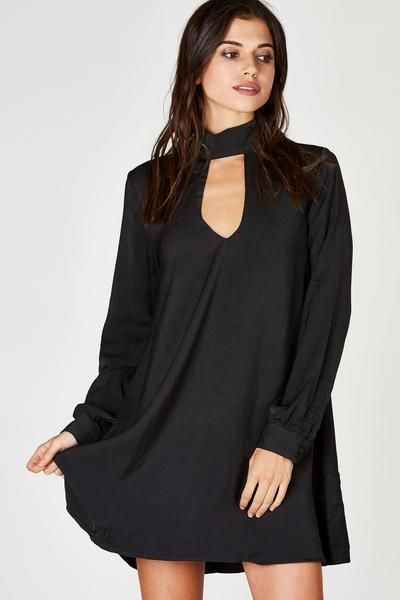 A simple chic mini dress with a sophisticated mock neck. Bold cut out in both front and back, this dress is anything but ordinary! Smooth chiffon exterior with an even smoother lining. Long relaxed sleeves, perfect for a business party!