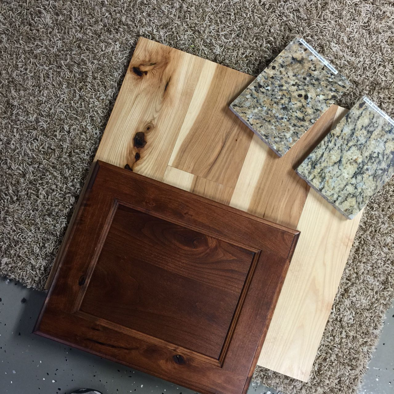 The natural hickory floor with train stain on shaker cabinets the