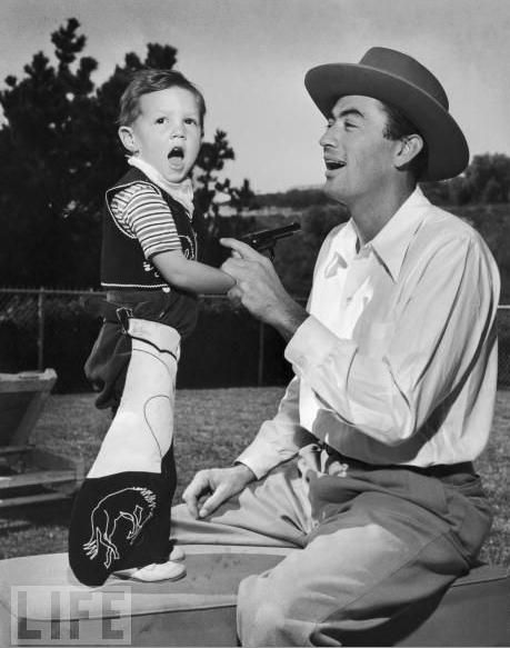 """GREGORY PECK said, """"I want to be remembered for being a good storyteller and more so for being a loving father, grandfather and a good husband."""" He is pictured here with his son Jonathon in 1946."""