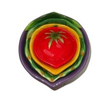Portraying veggies in vibrant colors, the Vegetable Nesting Bowls Set. An attractive and convenient way to display snacks and dips!