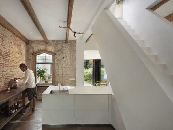 Antique brick and wood embellish railway house redesign in santpoort
