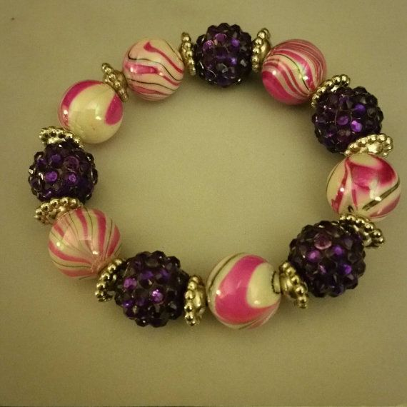 Check out this item in my Etsy shop https://www.etsy.com/listing/253546218/stretchy-bead-bracelet