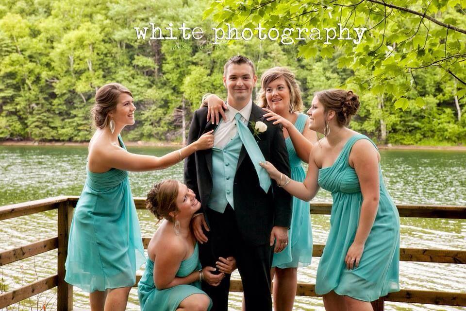 Lets maul the man ;) groom photo