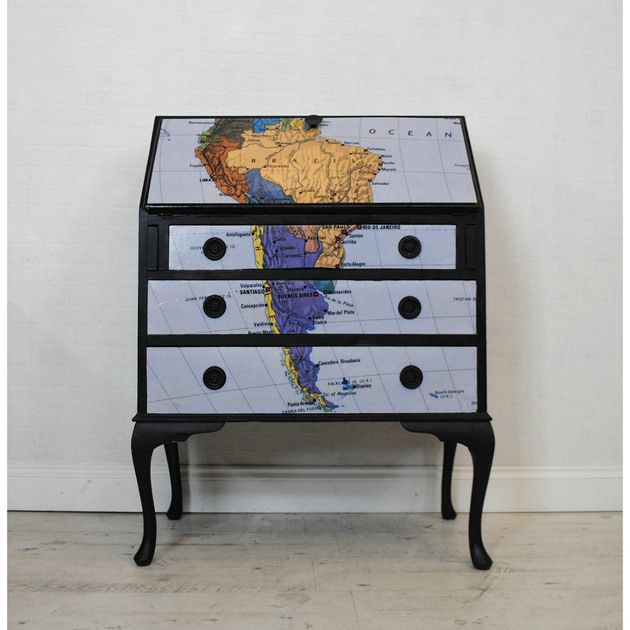 I love the idea of using maps on furniture.  Not so crazy about this particular map - would rather see an antique map.