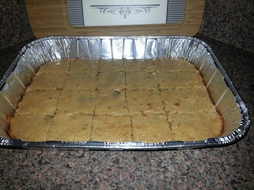 CHEWY PEANUT BUTTER BARS. EASY & CHEAP DESSERT!! Melt 1/2cup butter & 1/2cup peanut butter.  Add 1- 1/2 cups sugar, 1 cup AP flour, 2 eggs beaten, 1 tsp vanilla. Pour in 9x13 greased pan.Bake @ 350 degrees until lightly browned edges pull away from pan. Enjoy!!