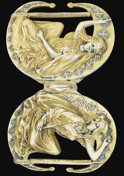 A SILVER-GILT BUCKLE. Representing TWO ALGERIAN WOMEN, SIGNED JB BELLOC, UNMARKED, PARIS, CIRCA 1900.
