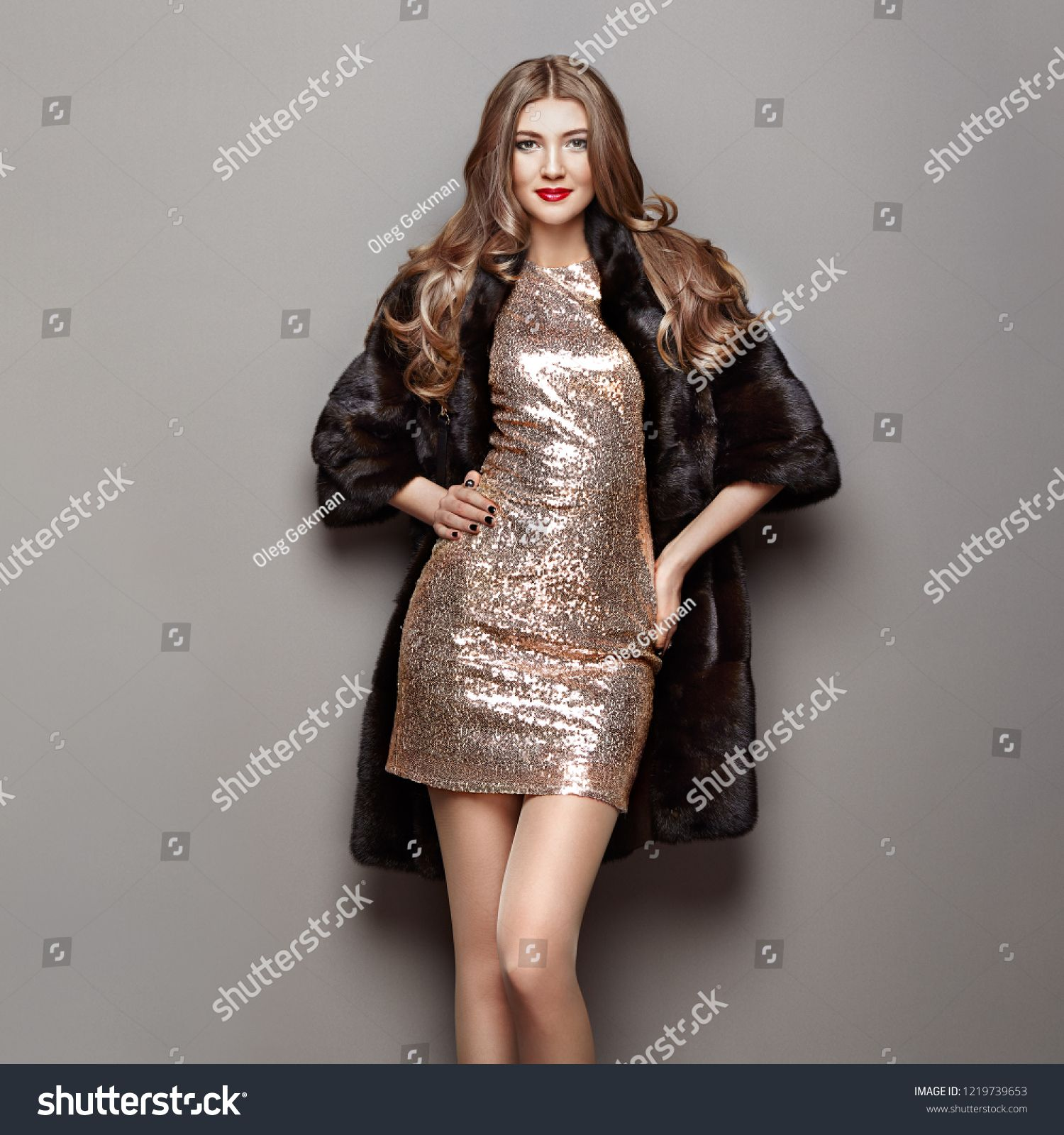 0d8f8d0643f Fashion Portrait Young Woman in Black Fur Coat. Girl with Elegant ...