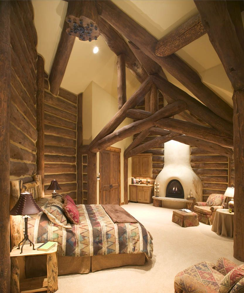 Warm bedroom with adobe style fireplace..this is perfect!