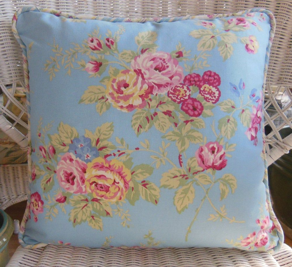 Decorator Pillow pink roses on a sky blue background, floral striped coordinating fabric on pillow back and piping