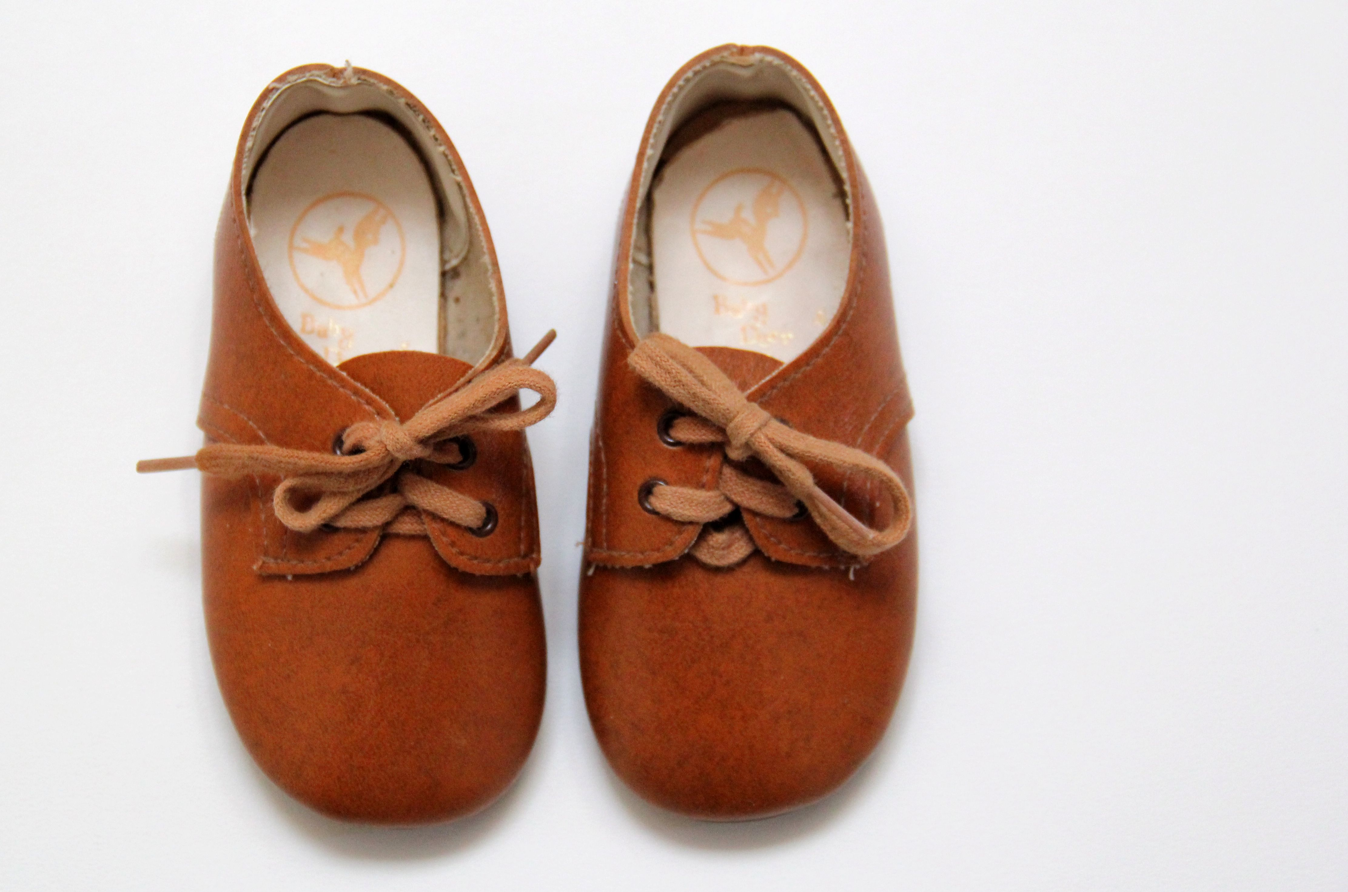 Vintage tan leather lace up baby shoes by Baby Deer