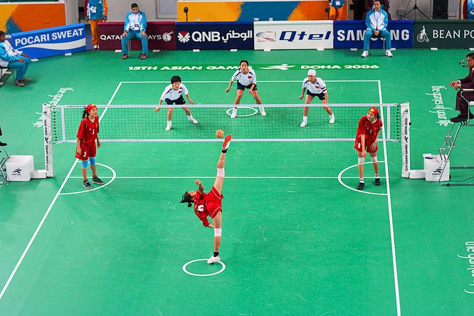 Nguyen Thi Bich Thuy of Vietnam serves the ball in a match against China in  the