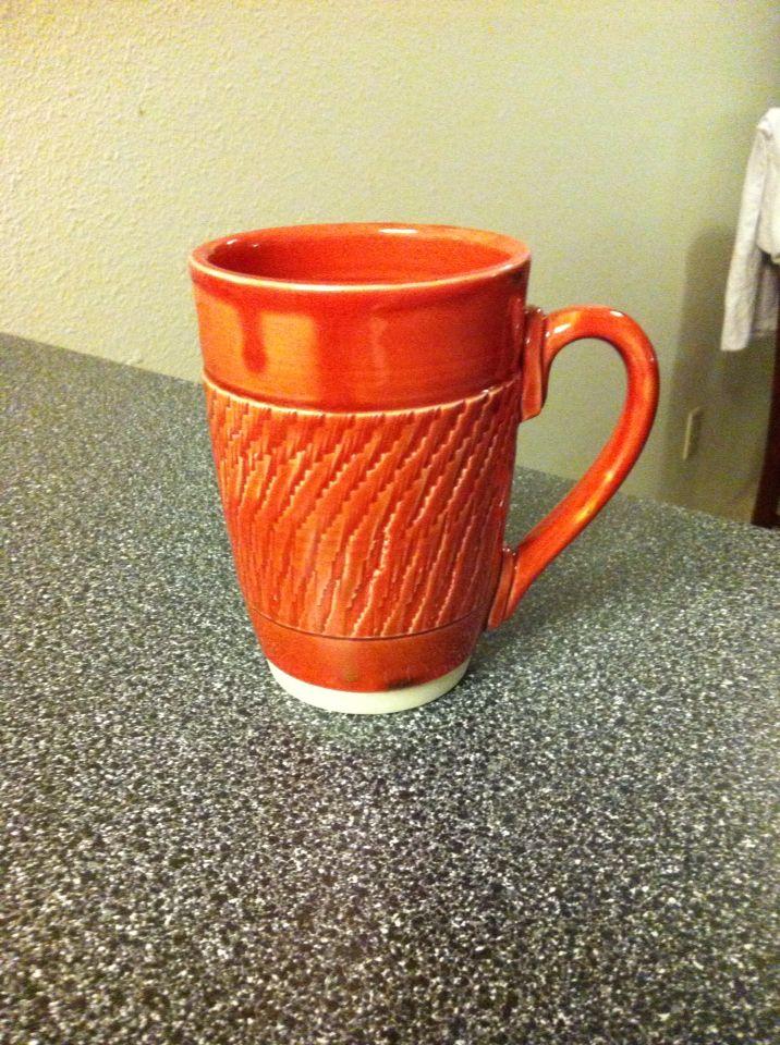 Wheelthrown mug with Fire Engine Red and Turkish Amber glaze