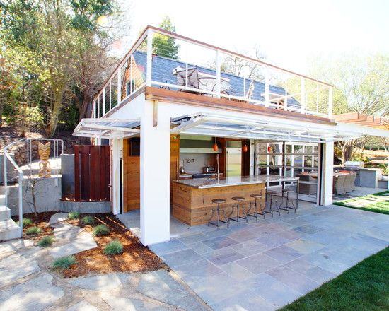 Guest House Featuring Indoor Outdoor Kitchen With Aircraft Hangar Style Doors And Recycled Cedar Cairn C Indoor Outdoor Kitchen Outdoor Remodel Rooftop Patio