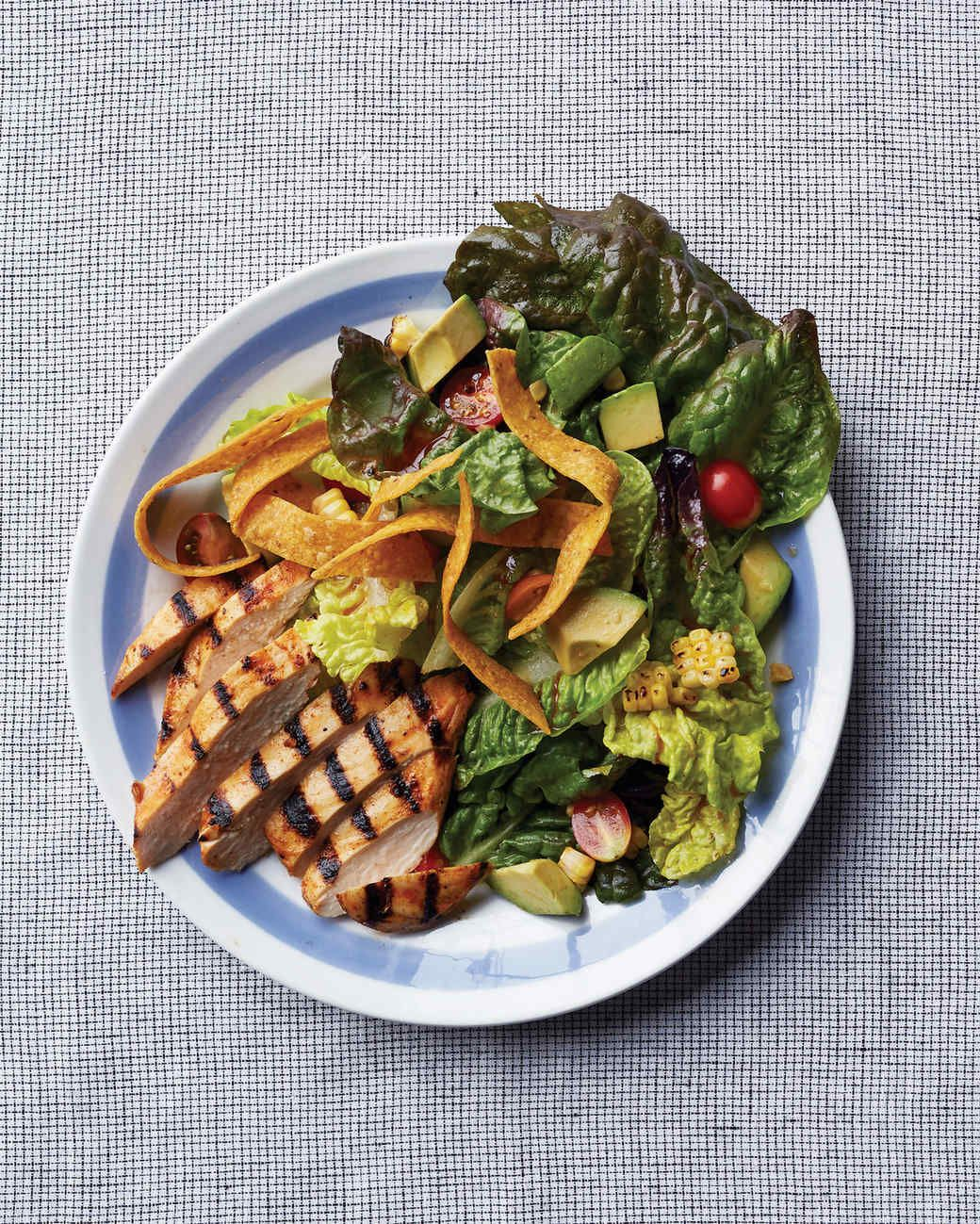 Barbecued-Chicken Salad | Martha Stewart Living - Toss flame-kissed chicken and corn with lettuce, avocado, cherry tomatoes, and tortilla chips for this smoky, satisfying salad.