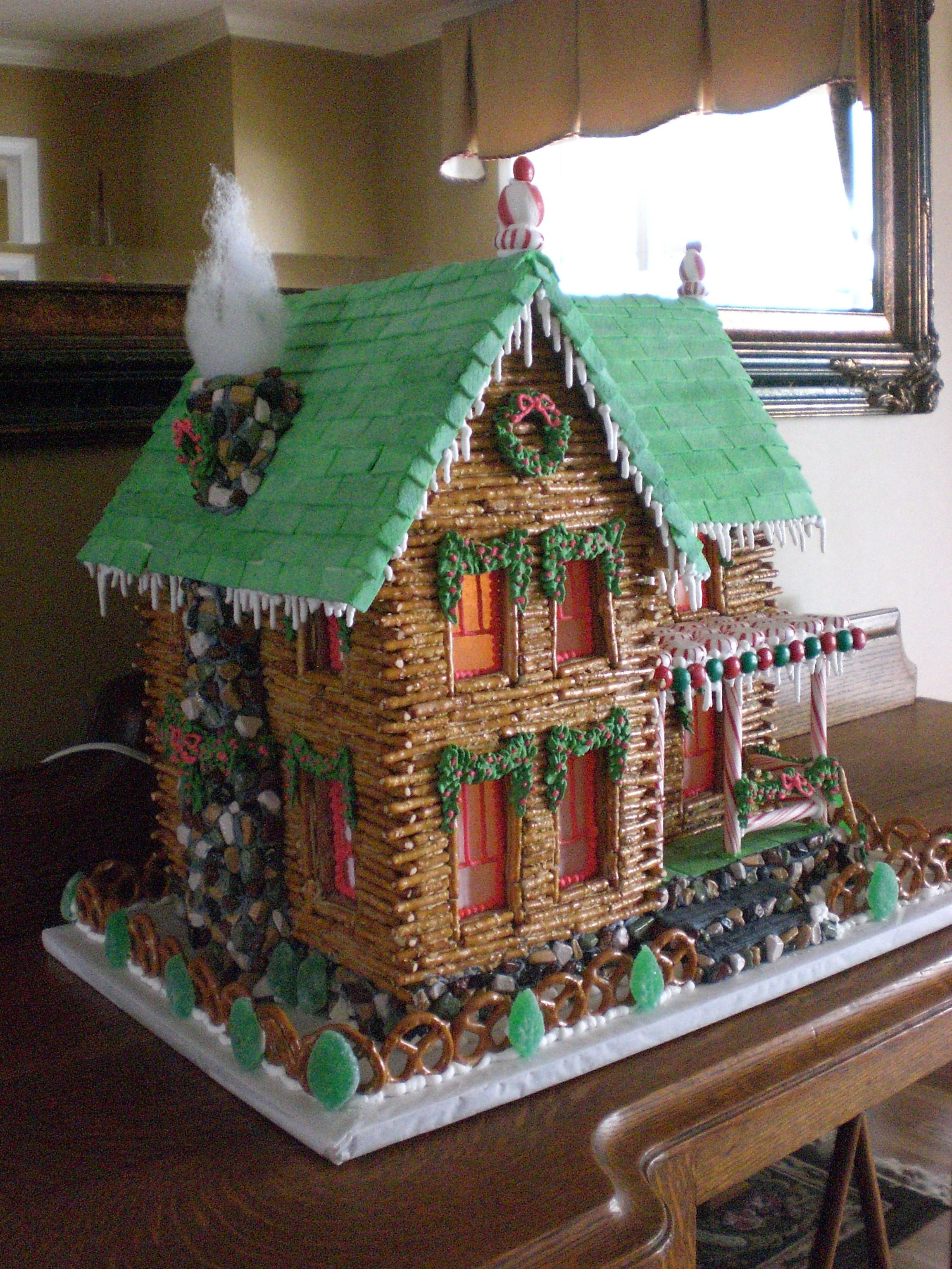 log cabin gingerbread with chimney. Gingerbread house