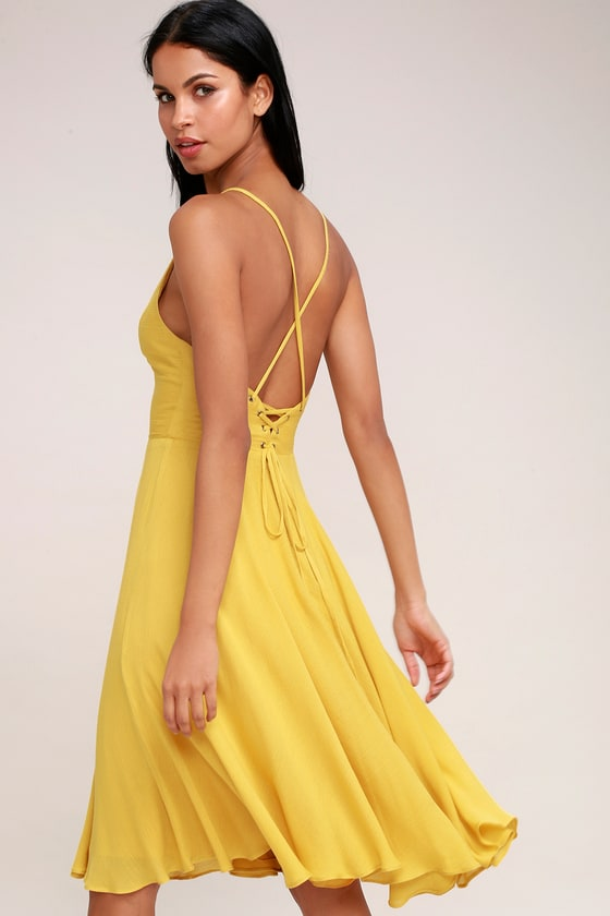 629d1a808e53 The Troulos Mustard Yellow Lace-Up Midi Dress is sure to make an  appearance! Skinny straps cross at back and then weave into a chic lace-up  back.