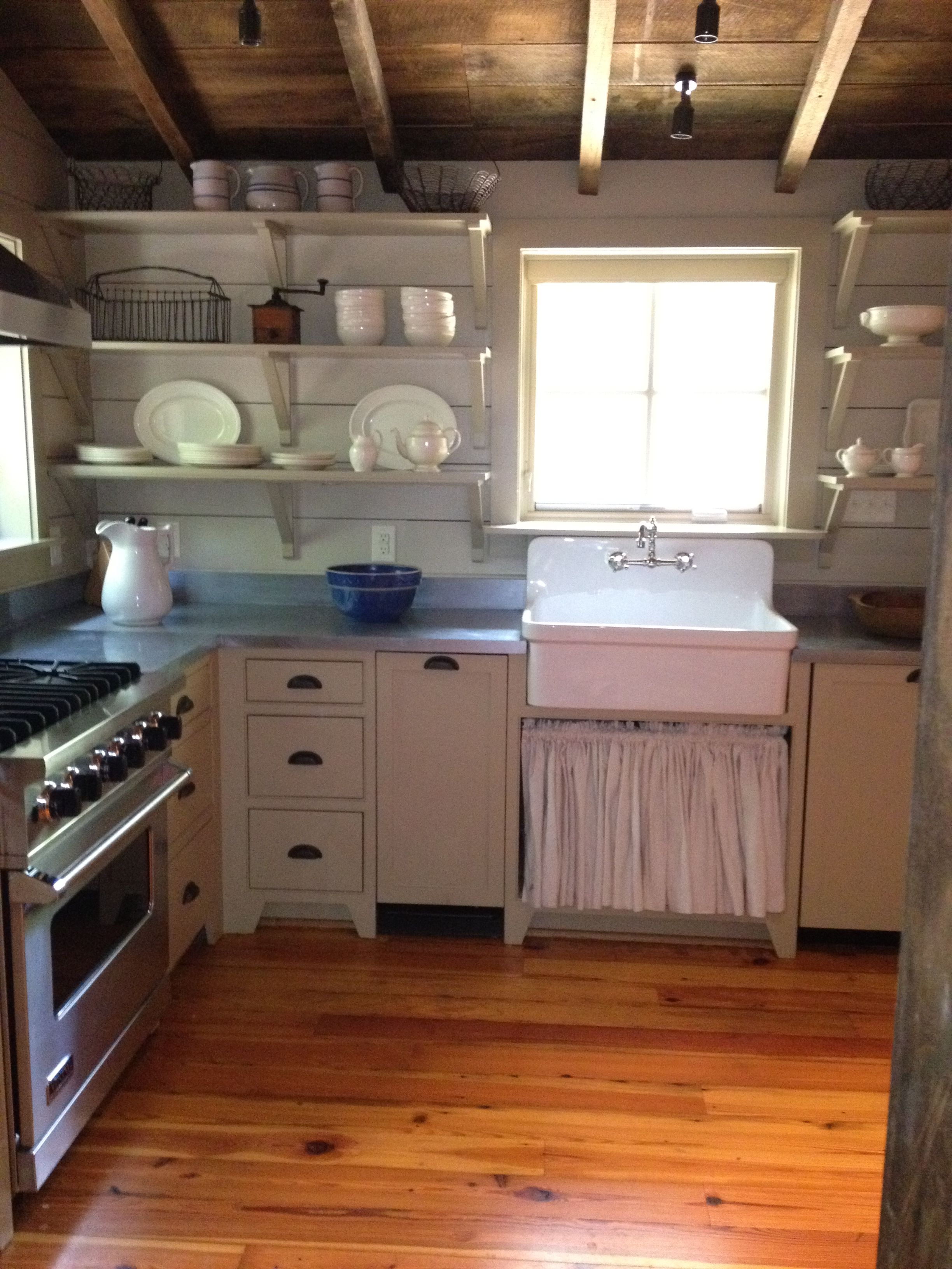 Another view of log house kitchen. The sink skirt is made from a ...