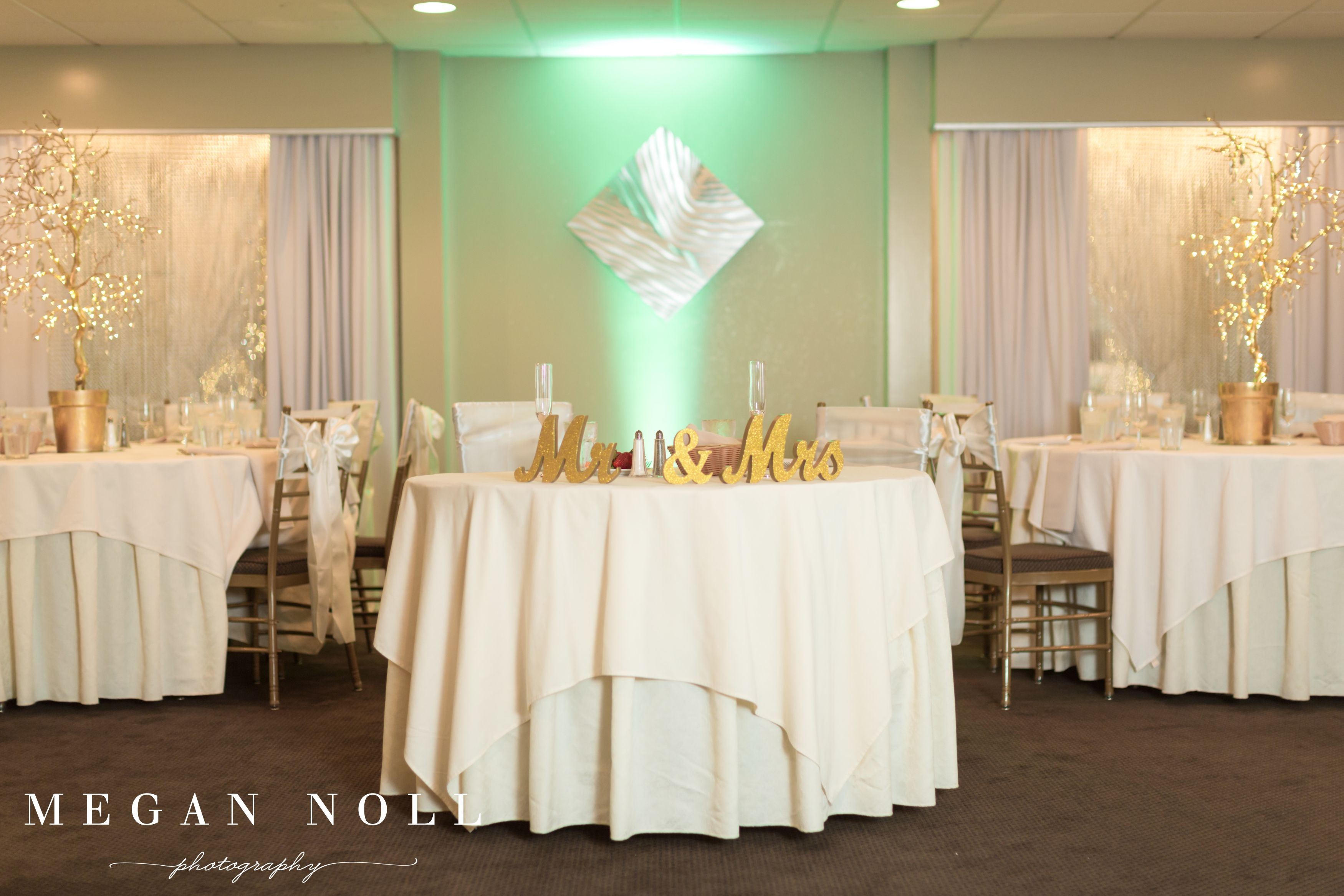 Head table on stage glamorous decor gold decor low ceiling
