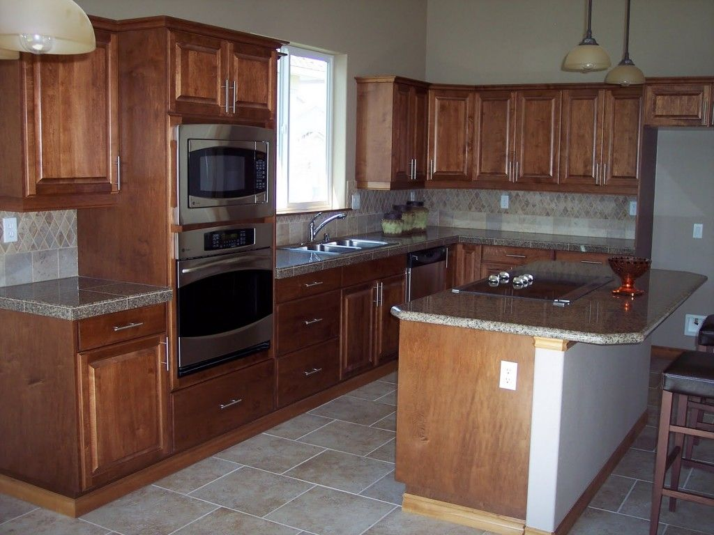 Granite counter with wood cabinets granite for Brown kitchen cabinets with black granite