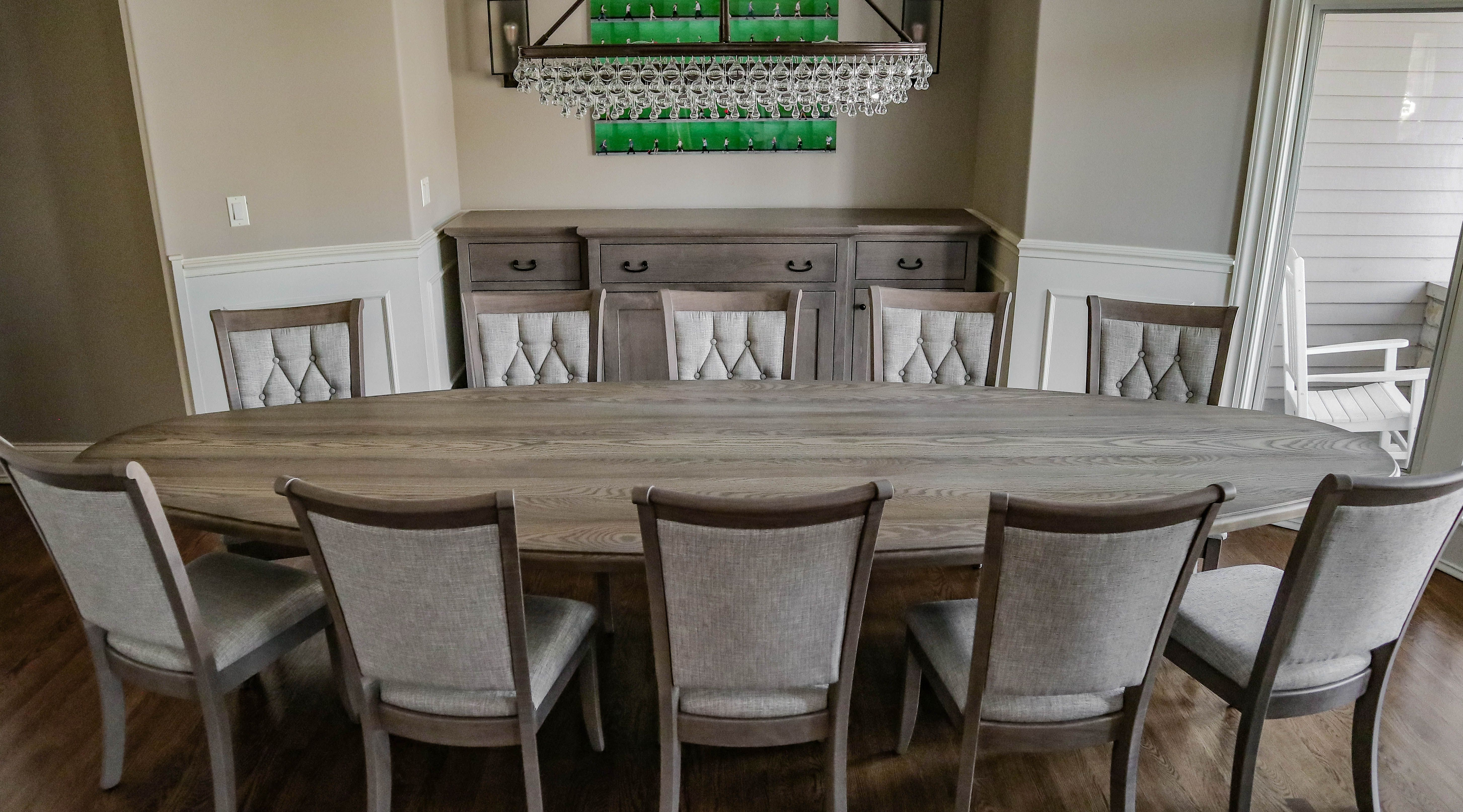 Table, chairs, and buffet finish off the furniture for this dining room. We built a custom oval table with a step down edge with chairs and a buffet to match.  #diningroomfurnishings #diningroomfurniture #diningroomtable #diningroomchairs #diningroombuffet #buffet #diningstorage #storagefurniture