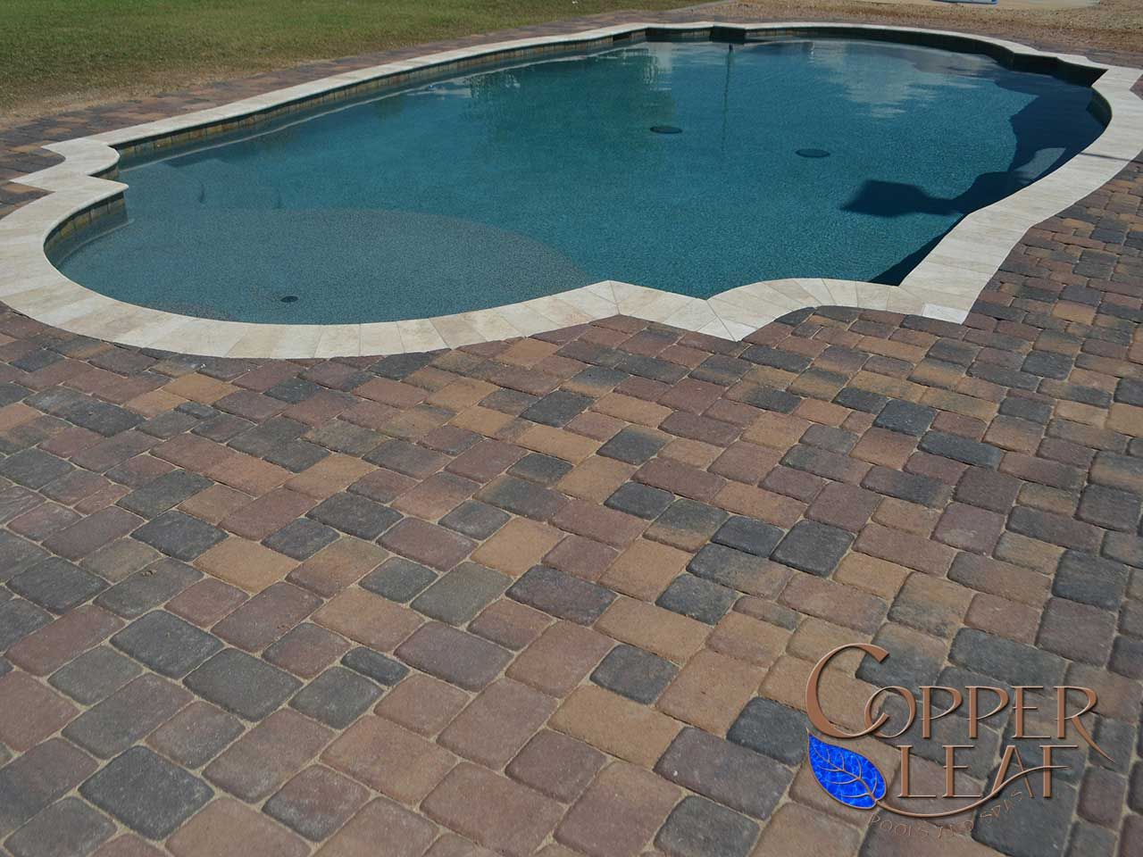 grecian pool - grecian style pool with travertine coping and