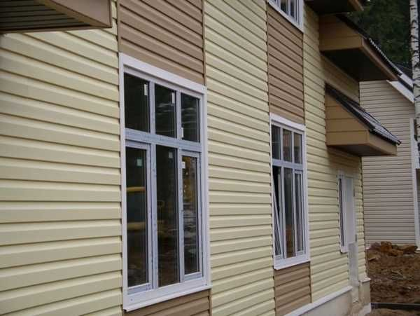 colorful vinyl siding improving curb appeal of modern houses with little maintenance