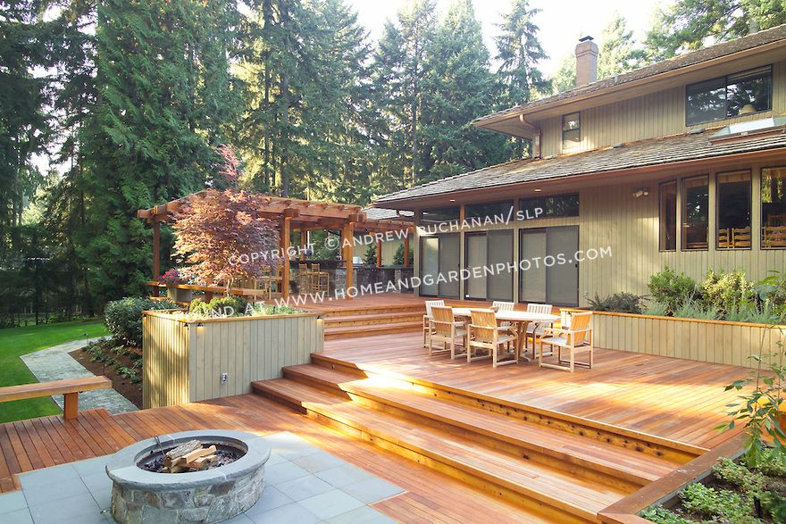 A 1700 Square Foot 2 Level Deck Outdoor Kitchen And Firepit Complete The Outside Of This Ranch S Backyard Landscaping Designs Backyard Backyard Seating Area