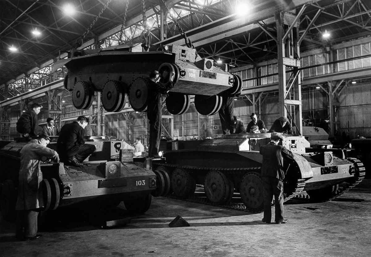 """c. 1942 Workers assemble """"Cruiser"""" tanks in a British factory."""