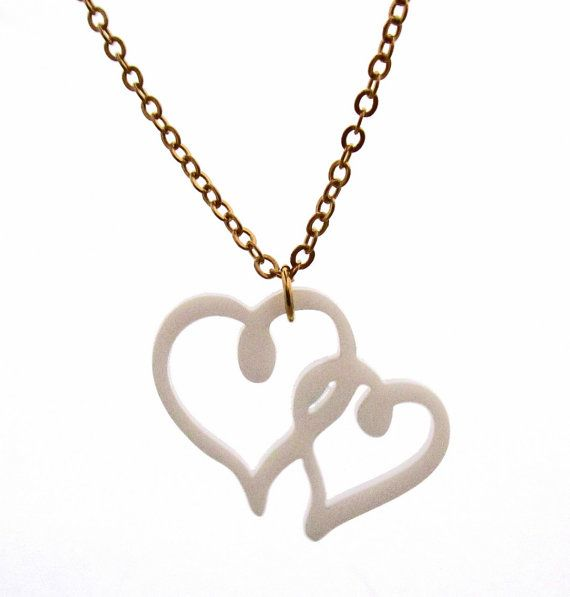 """Connected Heart Pendant Necklace   This Beautiful love necklace features a 1.18"""" (3 cm) heart pendant made of white acrylic. It comes on a gold plated cable chain.  The chain is approx.17.71"""" (45 cm) long.  A chic look for any occasion.  All of my jewelry comes with a gift box.   $32.9"""