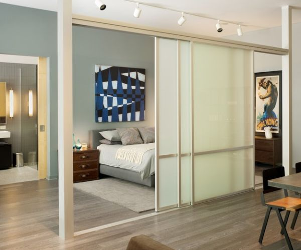 bedroom sliding doors. Separation with sliding glass doors and rail lighting for the bedroom