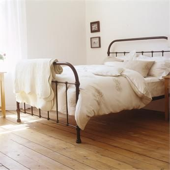 Best Iron Bed And Wide Pine Floors In This Simple Farmhouse 640 x 480