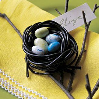 """Create a candy """"nest:"""" Twist two to three black-licorice laces to create a cup. Soften in microwave for 20 seconds. Reshape. Let cool, then nestle candy eggs inside. #Easter"""